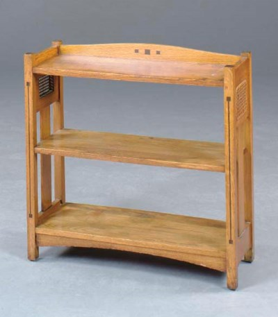 AN ARTS AND CRAFTS OAK AND EBO