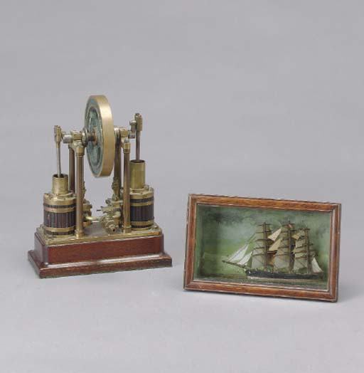A MINIATURE POLYCHROME DECORATED SHIP MODEL TOGETHER WITH A STEAM ENGINE REPLICA