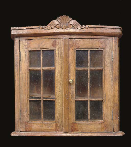 A GEORGE III STYLE WALNUT HANGING CABINET,