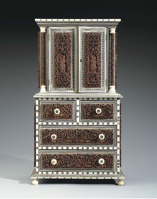 AN ANGLO-INDIAN INLAID IVORY AND HARDWOOD MINIATURE CABINET-ON-CHEST,**
