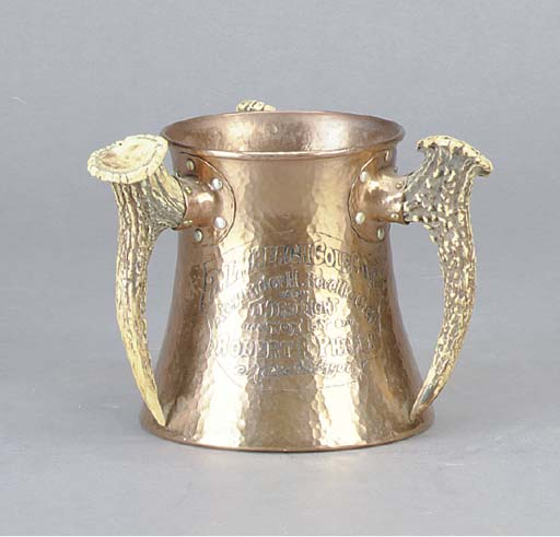 AN ENGRAVED COPPER AND HORN PRESENTATION CUP,