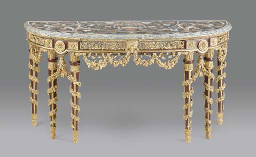 A NEOCLASSIC STYLE CARVED AND