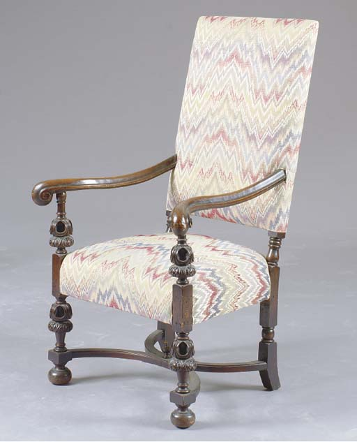A FLEMISH CARVED WALNUT OPEN ARMCHAIR,