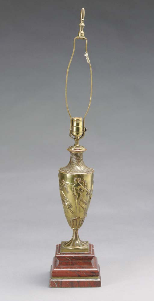 A FRENCH BRASS AND ROUGE GRIOT