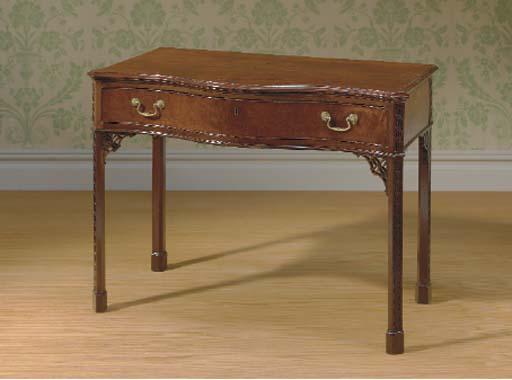 A GEORGE III MAHOGANY SERPENTINE SIDE TABLE,