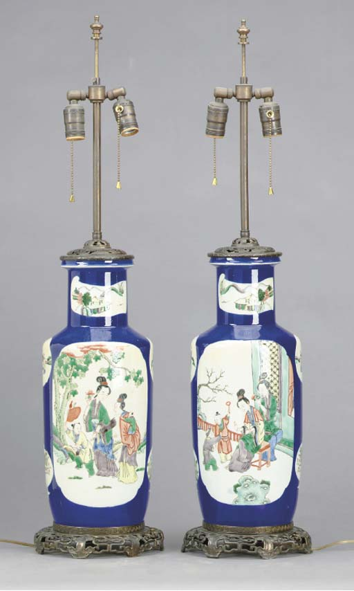 A PAIR OF CHINESE PORCELAIN FAMILLE VERTE COBALT BLUE GROUND ROULEAU FORM VASES MOUNTED AS LAMPS,