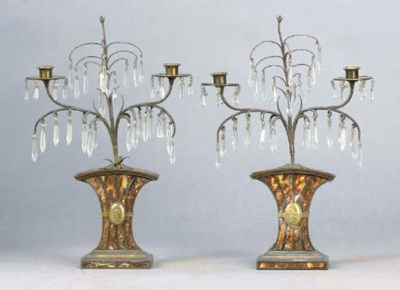 A PAIR OF REGENCY PATINATED BR