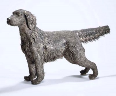A SILVER DOG TABLE ORNAMENT, B