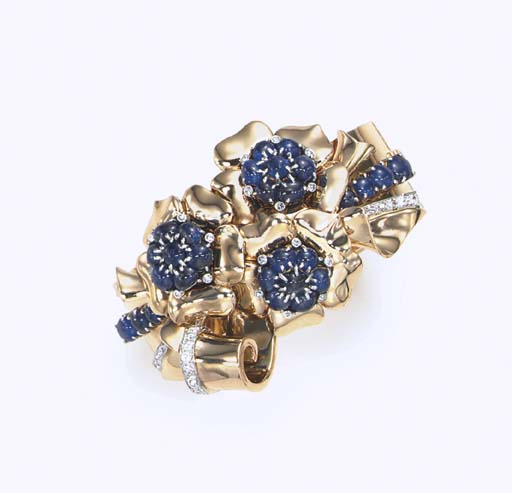 A RETRO SAPPHIRE, DIAMOND AND GOLD BRACELET, BY TRABERT & HOEFFER, MAUBOUSSIN
