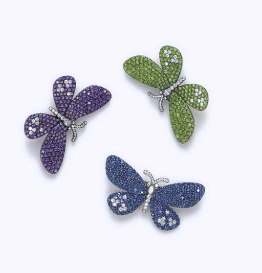 A SET OF MULTI-GEM BROOCHES
