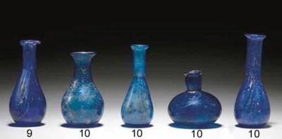 FOUR ROMAN GLASS BOTTLES
