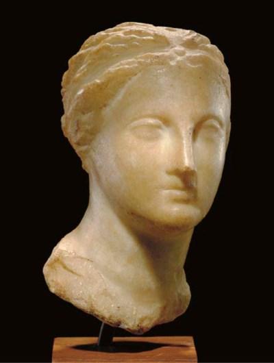 A GREEK MARBLE PORTRAIT BUST O