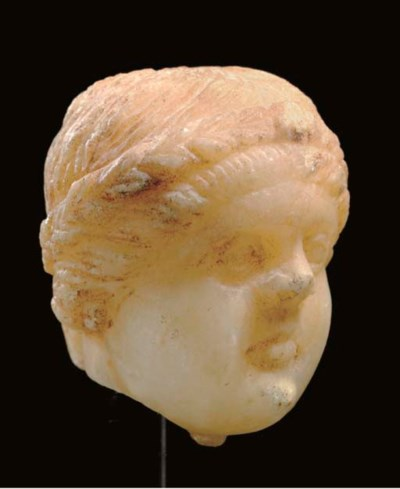 A GREEK MARBLE HEAD OF A GIRL