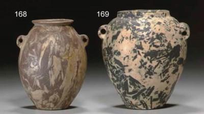 AN EGYPTIAN BRECCIA JAR