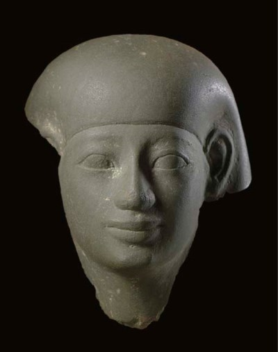 AN EGYPTIAN GREEN GRAYWACKE HE