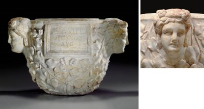 A ROMAN MARBLE CINERARY URN