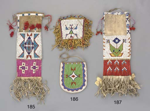 A SIOUX BEADED AND FRINGED TOB