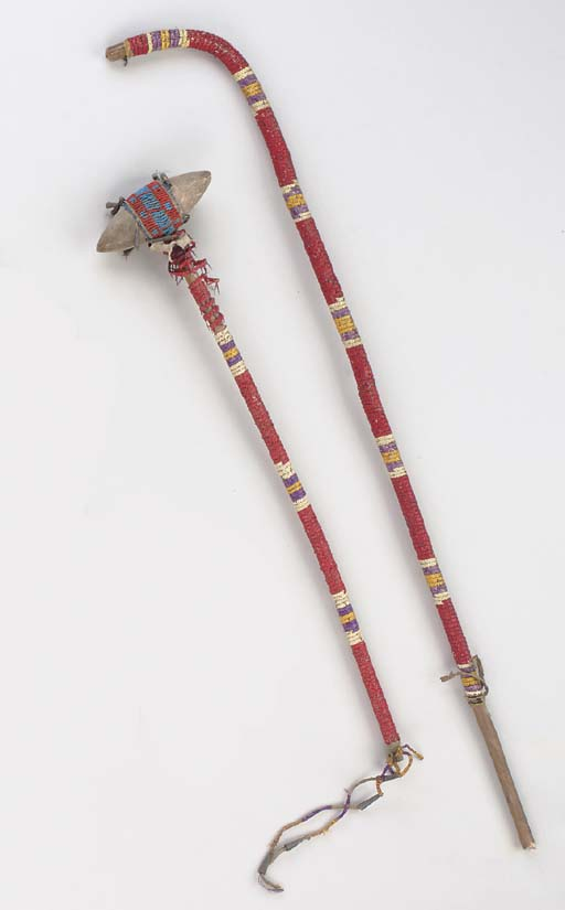A SIOUX QUILLED HIDE STONEHEAD