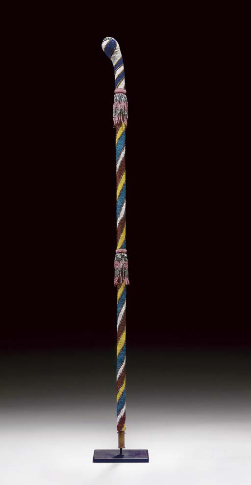 AN APACHE BEADED CANE