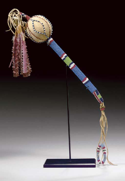 A COMANCHE BEADED HIDE RATTLE