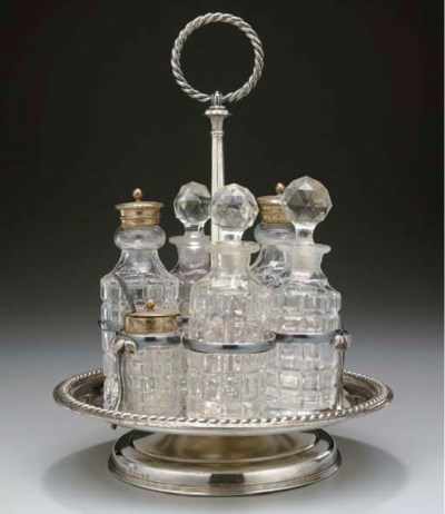 A sterling and crystal cruet s