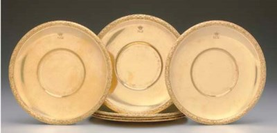 A SET OF SIX GOLD PLATES FOR T