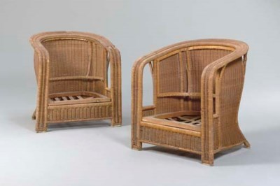 A PAIR OF WICKER ARMCHAIRS FRO
