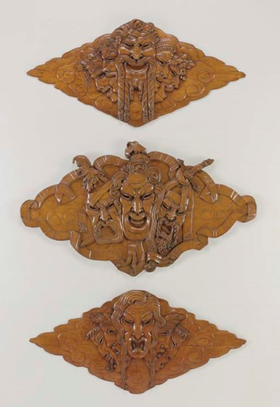 A SET OF THREE CARVED PANELS F