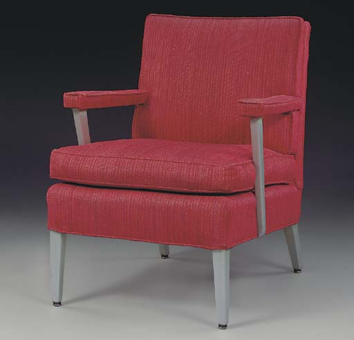 A RED LOUNGE CHAIR FROM A FIRST CLASS CABIN FOR THE S.S. UNITED STATES