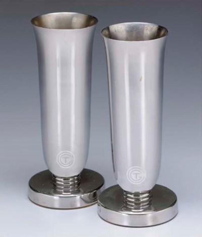 A PAIR OF CHROME METAL VASES F