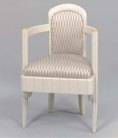 AN OPEN ARM CHAIR FROM 1ST CLA