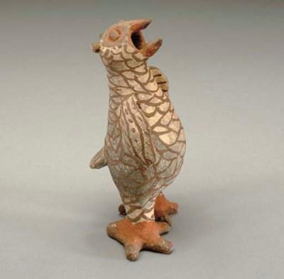 A ZUNI POLYCHROME POTTERY OWL
