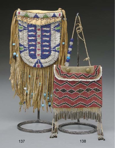 A SIOUX BEADED HIDE BELT POUCH