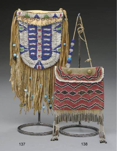 AN APACHE BEADED HIDE POUCH