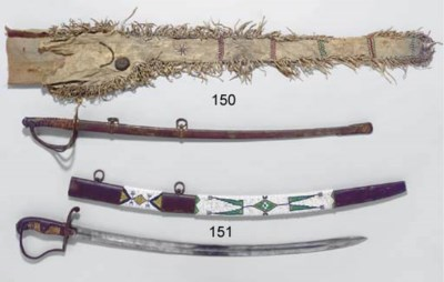 A SIOUX BEADED SWORD CASE AND