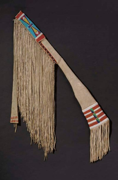 A CROW BEADED AND FRINGED HIDE