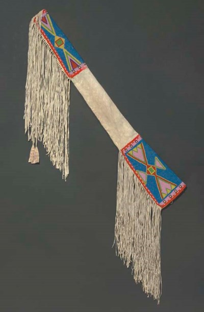 AN ASSINIBOIN BEADED AND FRING
