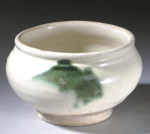 A CHINESE GREEN-SPLASHED CREAM