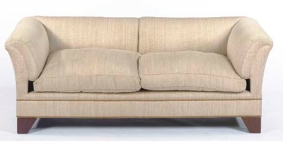 A CONTEMPORARY BEIGE UPHOLSTER