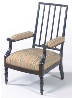 AN EBONISED UPHOLSTERED OPEN A