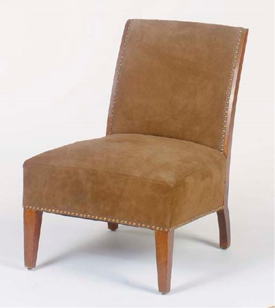 A BROWN SUEDE UPHOLSTERED LOW