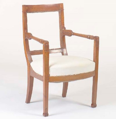 A CHARLES X FRUITWOOD ARMCHAIR