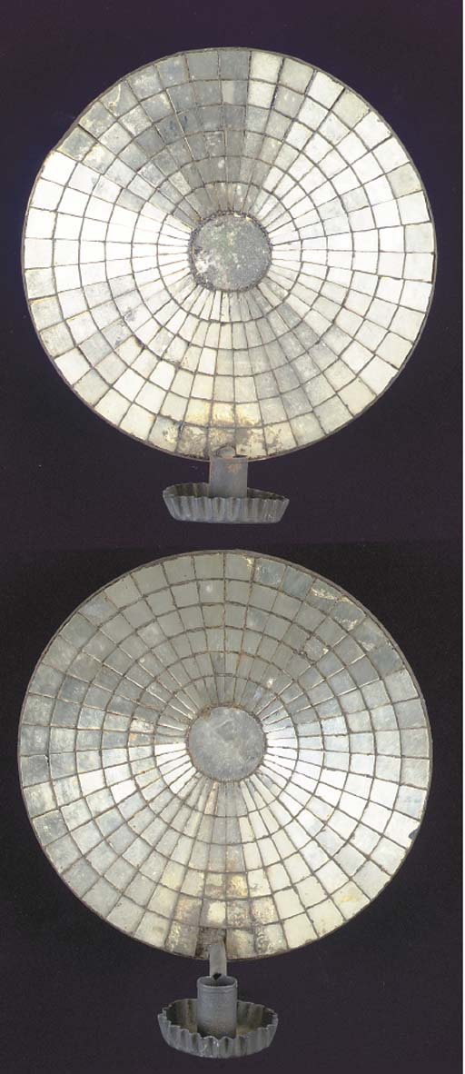 A PAIR OF MIRRORED TIN SINGLE-