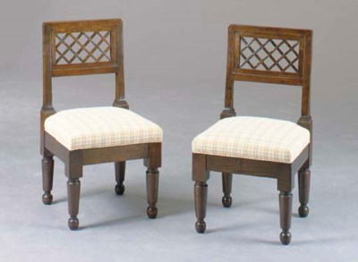 A SET OF TWELVE STAINED OAK PI