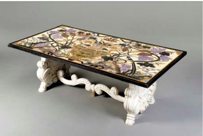A PIETRE DURE TABLE ON A CARVE