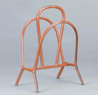 A BROWN LEATHER MAGAZINE RACK,