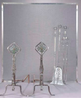 A PAIR OF WROUGHT IRON ANDIRON