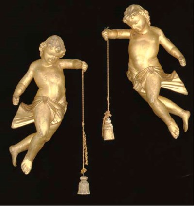 A PAIR OF CARVED GILTWOOD CHER
