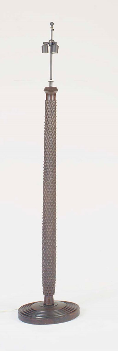 A CARVED OAK FLOOR LAMP,