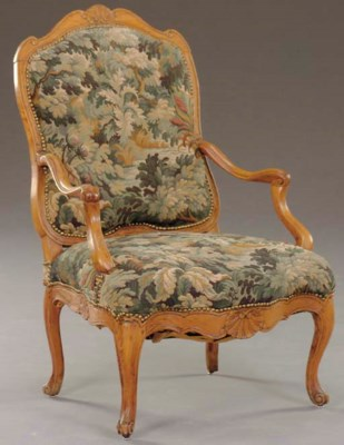 A LOUIS XV CARVED FRUITWOOD FA